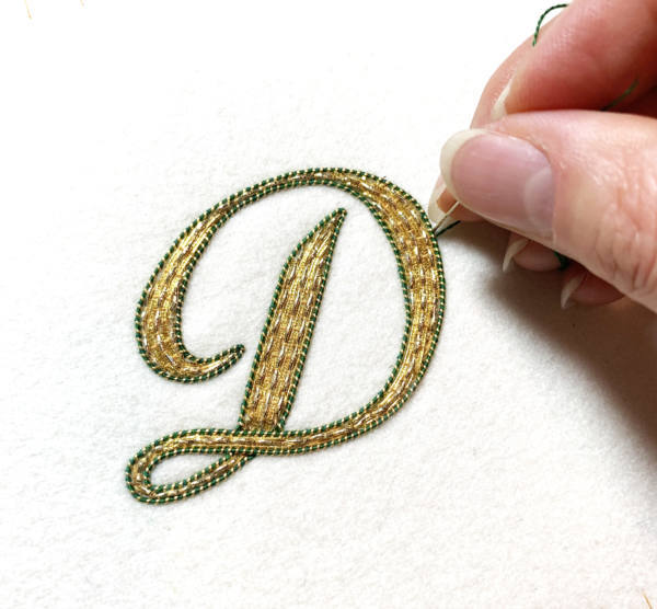 Goldwork, gold work monogram, monogramming, couching, Pearle Purl, gold wire, wire, thread, lettering, letters, green wire, product outcome, final outcome