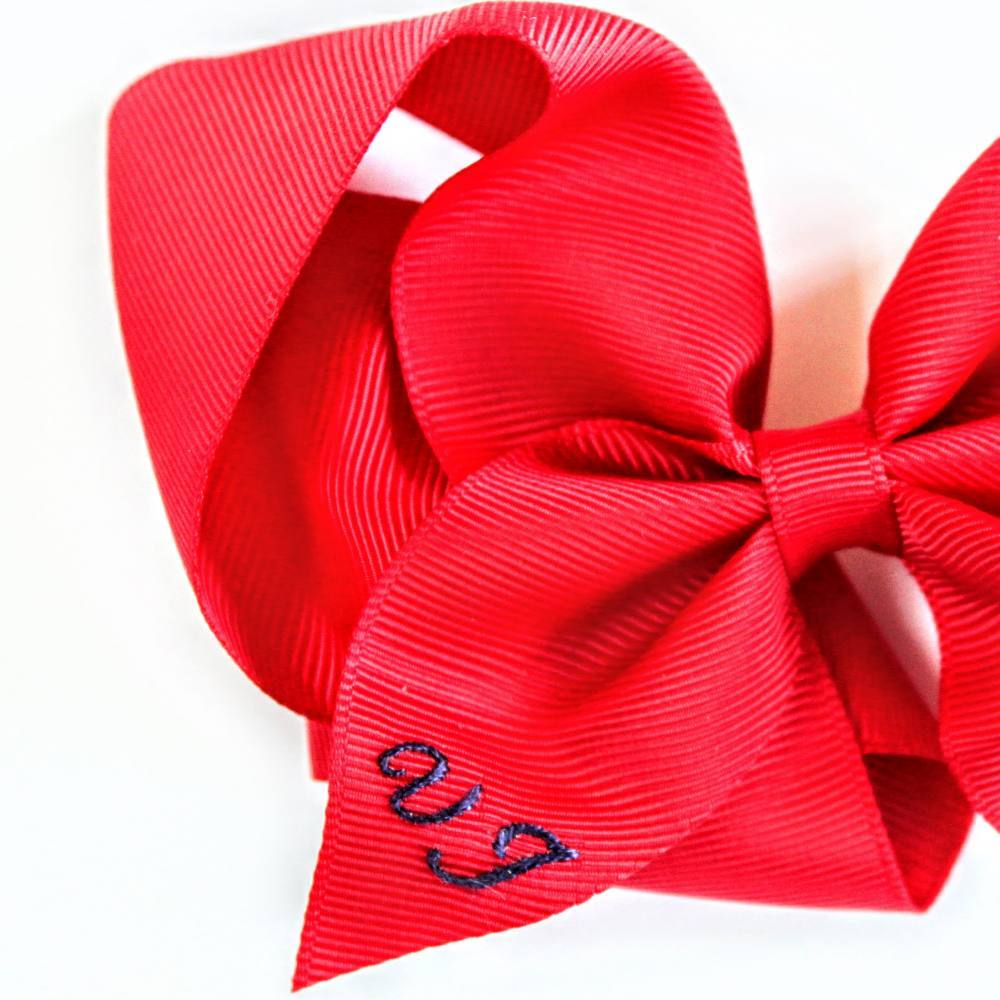 Monogram, monogramming, lettering, stitch, stitching, embroidery, textiles, red, red bow, accessories